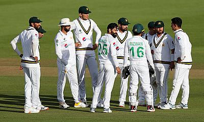 Pakistan players celebrate after Fawad Alam took the wicket of England's Chris Woakes