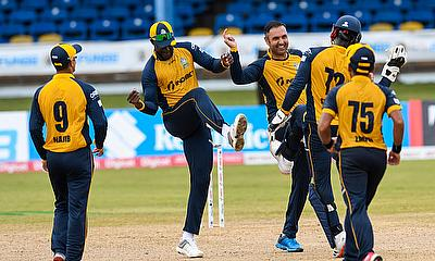 Mohammad Nabi (C) and Darren Sammy (2L) of St Lucia Zouks celebrate