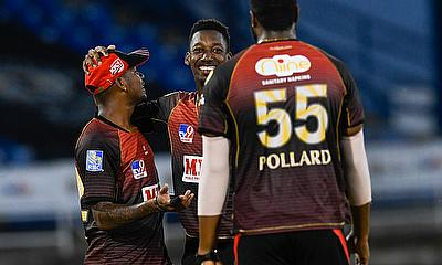 Khary Pierre (C) and Tion Webster of Trinbago Knight Riders celebrate the dismissal of Sherfane Rutherford of Guyana Amazon Warriors