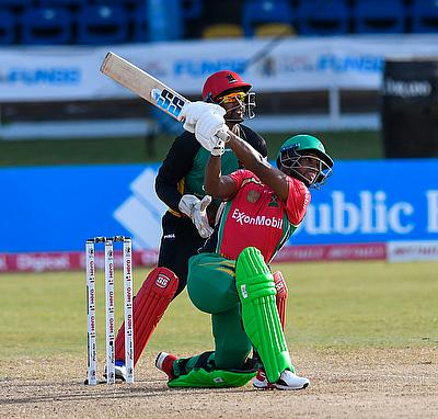 Nicholas Pooran (R) of Guyana Amazon Warriors hits 6