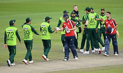 England's Dawid Malan and Lewis Gregory shake hands with Pakistan players after the match