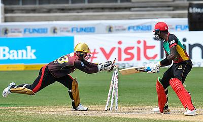 Alzarri Joseph (R) of St Kitts & Nevis Patriots dismissed by Tim Seifert (L) of Trinbago Knight Riders