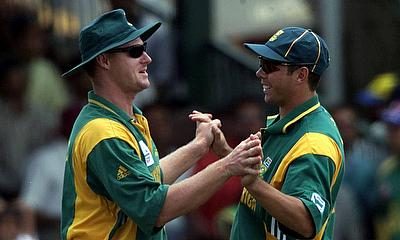 South Africa's Lance Klusener (L) and Nicky Boje (R) celebrate after Klusener caught England's Andrew Flintoff for 25