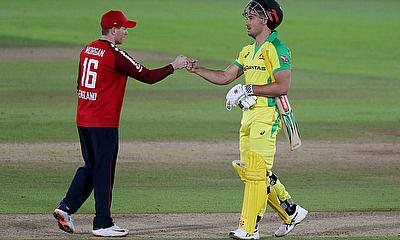 England's Eoin Morgan and Australia's Marcus Stoinis fist pump after the match