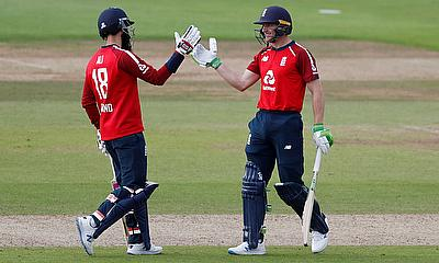 England's Jos Buttler and Moeen Ali celebrate after the match