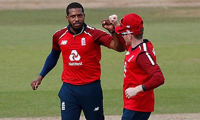England's Chris Jordan celebrates taking the wicket of Australia's Aaron Finch