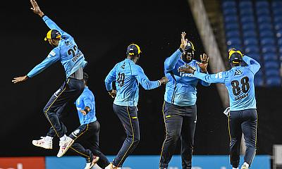 Rahkeem Cornwall (2R) of St Lucia Zouks celebrates the dismissal of Imran Tahir of Guyana Amazon Warriors
