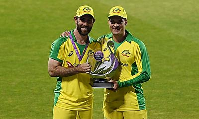 Australia's Glenn Maxwell and Alex Carey pose with the trophy after winning the match and the series