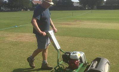 Clive Brown in action with the Dennis Mower