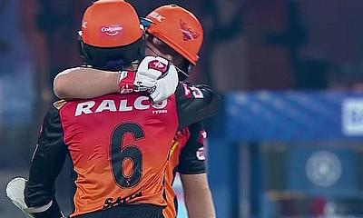 David Warner and Wriddhiman Saha celebrate