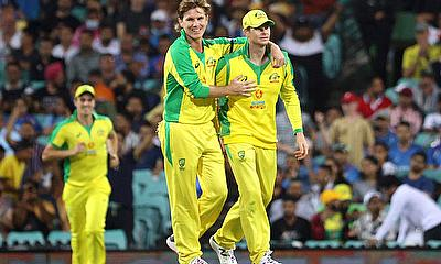 Australia's Adam Zampa and Steven Smith celebrate