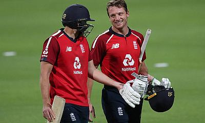 England's Dawid Malan and Jos Buttler celebrate after winning the series