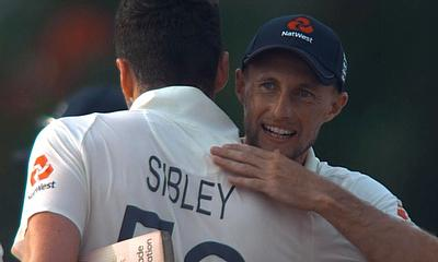 Dom Sibley gets a hug from Joe Root