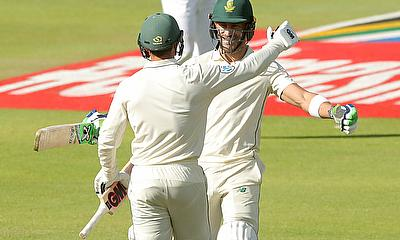South Africa's Faf du Plessis celebrates his century with Temba Bavuma