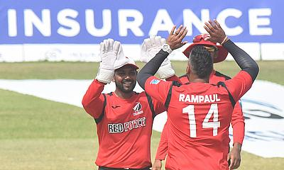 Ravi Pampaul celebrates a wicket with keeper Denesh Ramdin