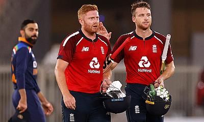 England's Jos Buttler and Jonny Bairstow celebrate winning the match