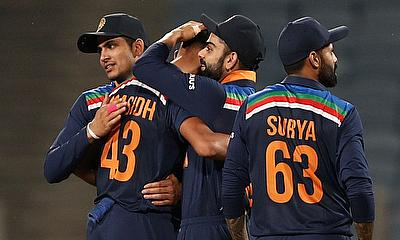 India's Prasidh Krishna celebrates taking the wicket of England's Tom Curran with teammates and winning the match