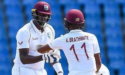 Kraigg Brathwaite  and  Jason Holder