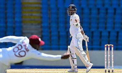 Nkrumah Bonner takes a superb catch to dismiss Dimuth Karunaratne