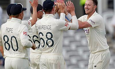 Ollie Robinson celebrates a wicket for England