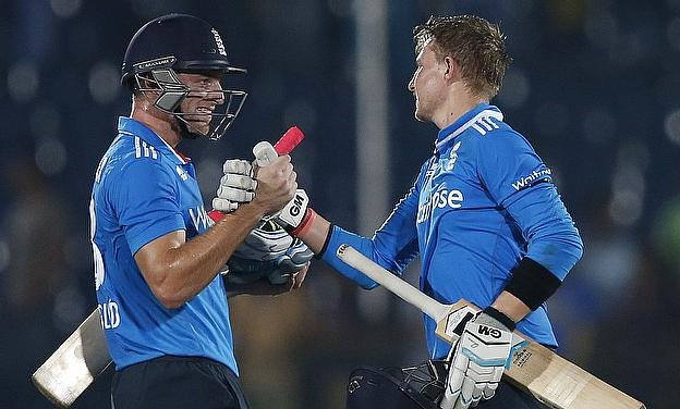 Jos Buttler (left) and Joe Root congratulate each other following their match-winning partnership