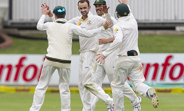 Nathan Lyon is congratulated