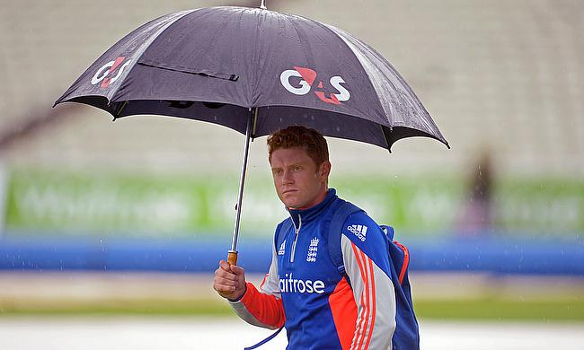Jonny Bairstow shelters from the rain at Edgbaston