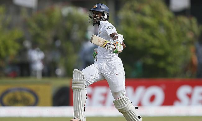 Dinesh Chandimal celebrating his century against India on day three of the first Test in Galle.