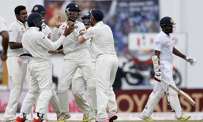 Indian players celebrating the wicket of Lahiru Thirimanne on day five of the second Test in Colombo.