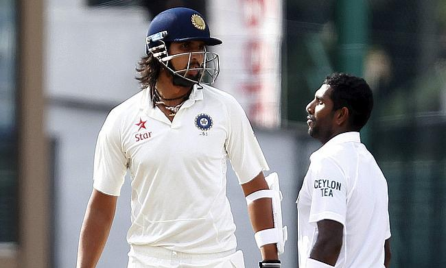 India's Ishant Sharma (left) argues with Sri Lanka's Dhammika Prasad (right) during the fourth day of their third and final test cricket match in Colo