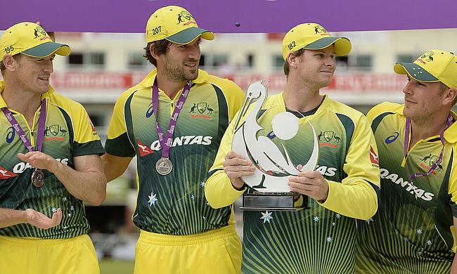 Australia's Steven Smith holds the trophy as he celebrates with team mates after winning the one-day series.