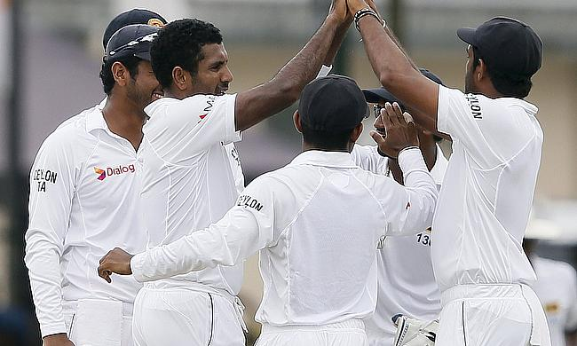 Dhammika Prasad takes four as Sri Lanka build a lea