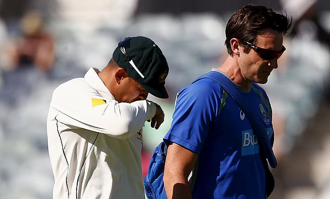 Usman Khawaja (left) leaving the field after picking a hamstring injury on day two of the Perth Test.