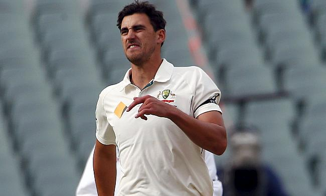 Mitchell Starc reacts as he sustains a foot injury on the first day of the third Test against New Zealand in Adelaide.