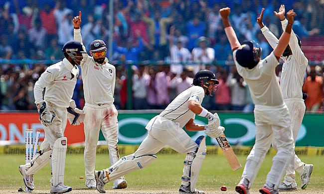 Indian players celebrating the final wicket of New Zealand on day five of the first Test in Kanpur.