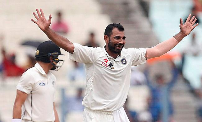 Mohammad Shami (right) celebrating the wicket of BJ Watling at Eden Gardens