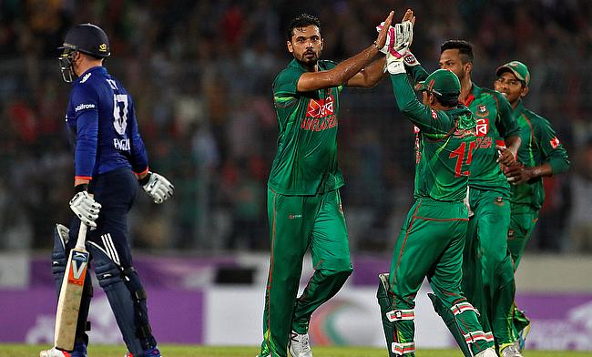 Mashrafe Mortaza celebrating the wicket of Jason Roy (left).