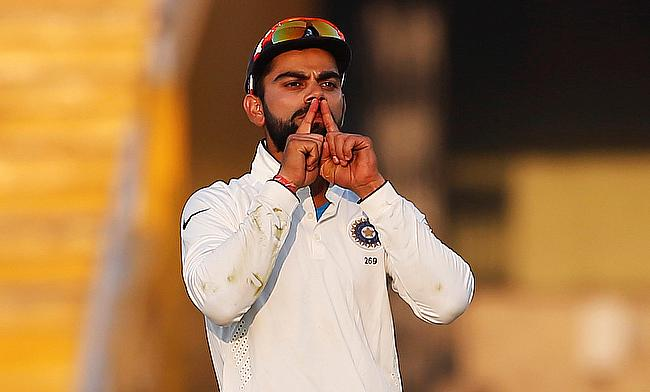 Virat Kohli reacts after dismissing Ben Stokes.