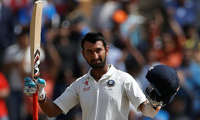 Cheteshwar Pujara celebrating his century on day three of the Ranchi Test