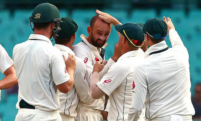 Nathan Lyon (centre) dented India's momentum on the second day