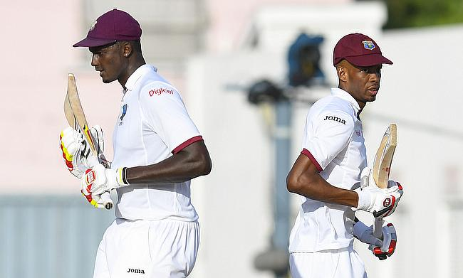 Jason Holder (left) and Roston Chase saved the day for West Indies in Barbados