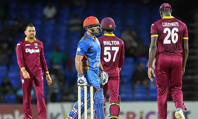 Sunil Narine (left) celebrating the wicket of Shafiqullah