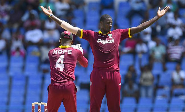 Jason Holder (right) picked a five wicket haul for West Indies