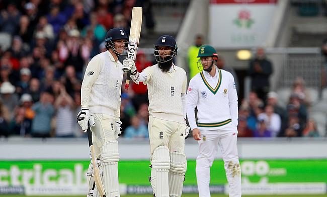 Moeen Ali (centre) celebrating his century on day three at Old Trafford
