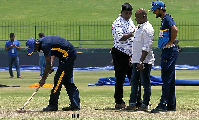 Sri Lanka's cricket team captain Dinesh Chandimal and chairman of selection committee Sanath Jayasuriya inspect the pitch ahead of their final test ma