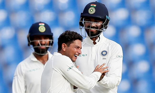 Kuldeep Yadav (centre) picked a four wicket haul