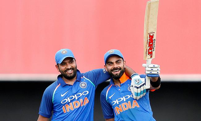 Rohit Sharma (left) and Virat Kohli added 219 runs for the second wicket