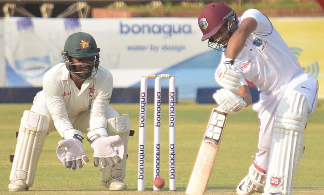 Shai Hope (right) remained unbeaten on 90 in the first day in Bulawayo