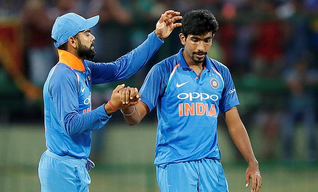 Jasprit Bumrah (right) picked three wickets