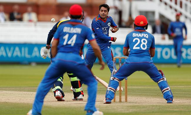 Rashid Khan (centre) scored 48 runs and picked three wickets as well